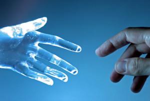 Human hand touch an atrifical glass hand